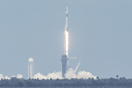 SpaceX Falcon 9 rocket carrying the Crew Dragon spacecraft with two astronauts takes off from NASA's Kennedy Space Center in Cape Canaveral of Florida, the United States, on May 30, 2020. (Photo by Ting Shen/Xinhua)
