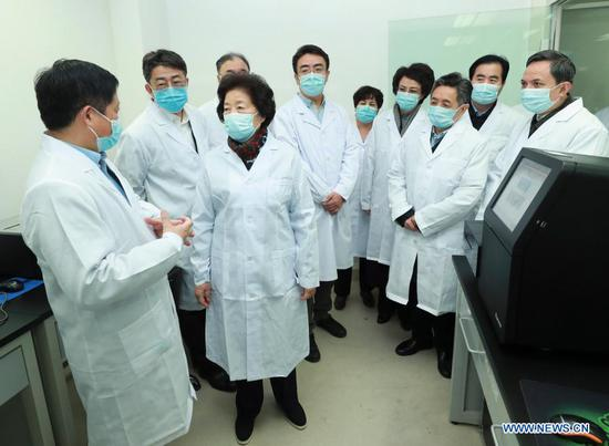 Chinese Vice Premier Sun Chunlan, also a member of the Political Bureau of the Communist Party of China Central Committee, inspects the Chinese Center for Disease Control and Prevention on Dec. 3, 2020. (Xinhua/Pang Xinglei)