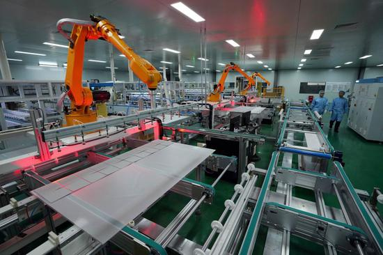 Photo taken on Dec. 11, 2018 shows the photovoltaic module production line of a company in De'an, east China's Jiangxi Province. (Xinhua/Song Zhenping)